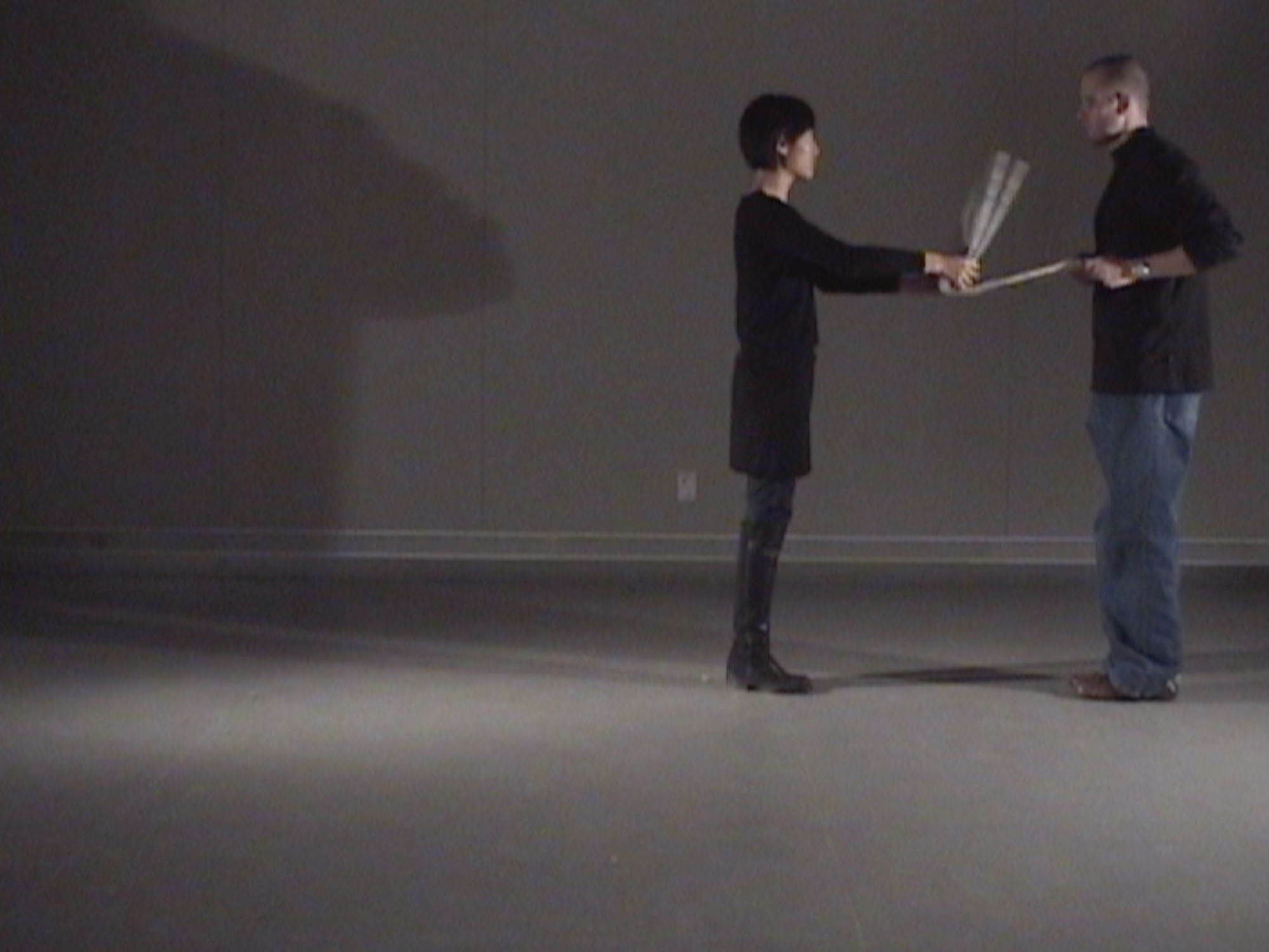 Finational [Canadian Flag] (2008) (performance still) by Annie Onyi Cheung